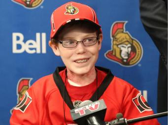 General manager of the Ottawa Senators, Bryan Murray (l), Pierre Dorion and Randy Lee (R) sign Jonathan Pitre as a pro scout for one day at the Canadian Tire Centre in Ottawa, November 20, 2014. Photo by Jean Levac/Ottawa Citizen